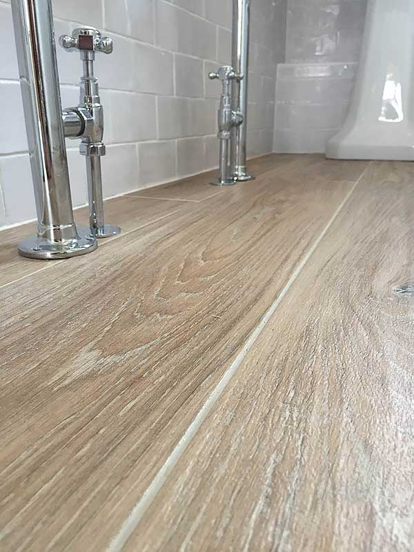 The bathroom blog floors of stone for Wood effect vinyl flooring bathroom
